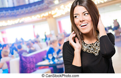 Beautiful young woman smiling at a restaurant