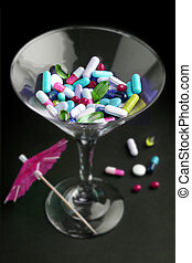 cocktail of drugs in a glass on black background