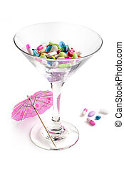 cocktail glass with medicines and paper umbrella