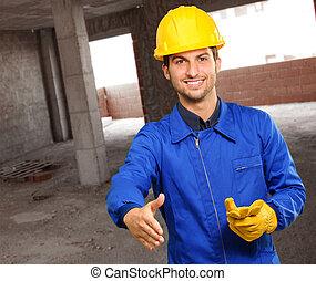 Young Engineer Offering Handshake, Indoors