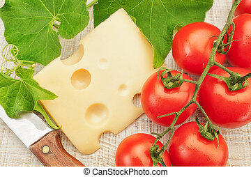 Composition with vegetables and cheese knife for cutting.