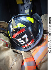 Firefighter hat helmet on Jacket - A firemans black helmet...