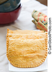 Jamaican Beef Patties - Three Jamaican beef patties on a...