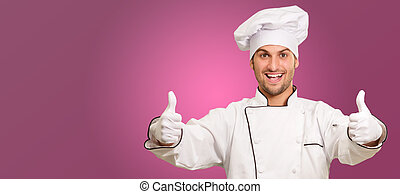 Portrait Of A Male Chef With Double Thumb Up Sign On Pink...
