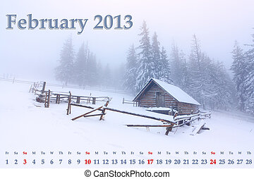 2013 Calendar. February. Foggy winter landscape in the mountains.