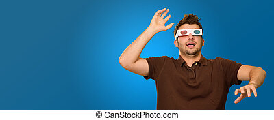Young Man Wearing 3d Glasses Isolated On Blue Background