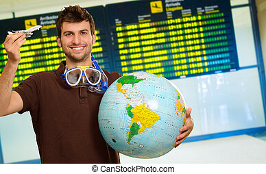 Man With Snorkel Holding Globe And Miniature