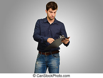 Young Man Holding Clipboard
