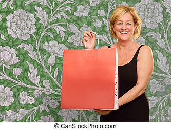 Happy Elderly Woman With Shopping Bag