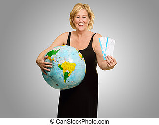 Mature Woman Holding Globe And Boarding Pass