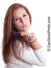cute young female blowing a kiss ,white background