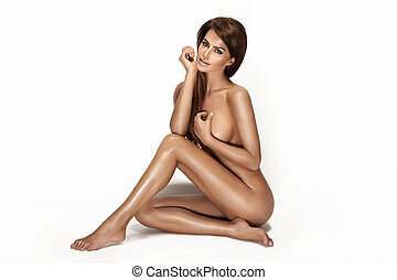 Picture of healthy naked beautiful woman over white -...