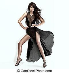 Romantic brunette beauty wearing black dress