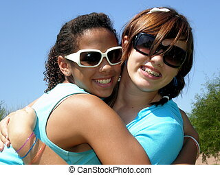 Hugs - A picture of two young teen girls hugging each other.