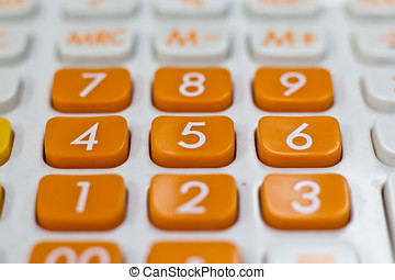Taxation concept - Orange calculator with the word TAX added...