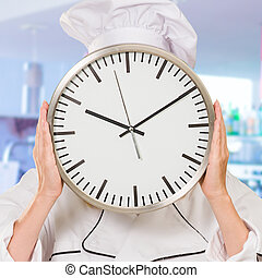 Portrait Of A Chef Holding Wallclock, Indoors