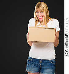 Woman Holding Cardboard box against a black background