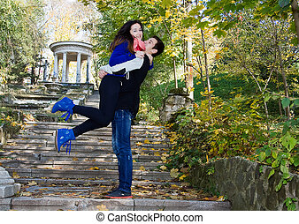 Happy smiling embracing couple being together in nature