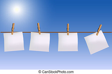 Four paper notes hanging on rope
