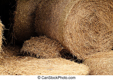 hay bales in a field detail - A close-up shot of a large...