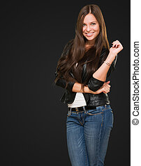 young happy woman posing against a black background