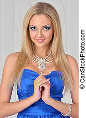 Beautiful blonde woman in blue gown