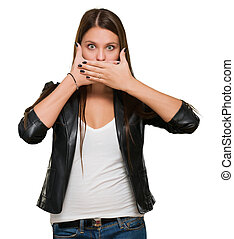 Shocked woman covering her mouth against a white background