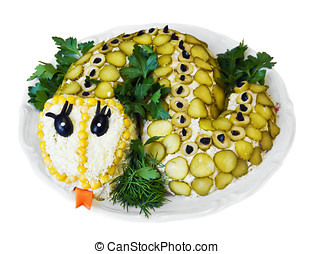 salad vegetables laid out in the form of a snake