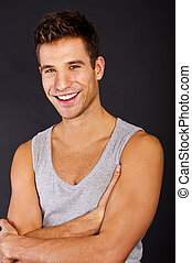 Handsome man in gray tanktop with smile - Man in the gray...
