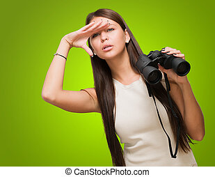 Portrait Of A Young Woman Holding Binoculars And Searching...