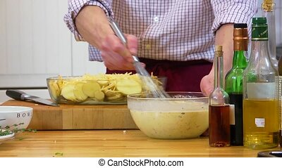 Whisking batter in a bowl - Tilted shot of a chef, mixing...