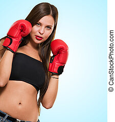 Female Model Wearing Boxing Gloves against a blue background