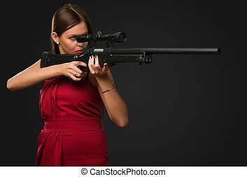 Girl Aiming With Gun against a black background