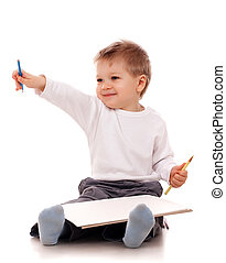 Boy drawing with a pencil over white background