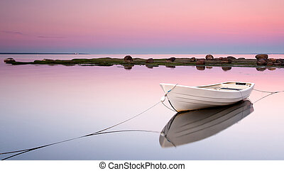 White boat at pinky sunset