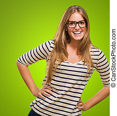 Portrait Of Young Woman against a green background