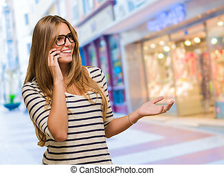 Young Woman Using Cell Phone, outdoor