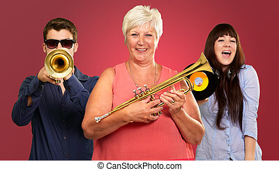 Happy Family Enjoying Music On Red Background