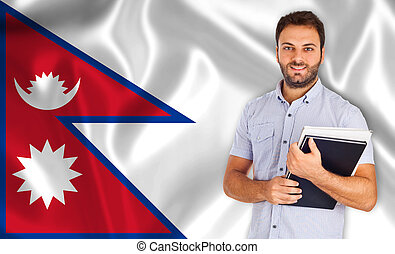 Male student of languages on Nepal flag