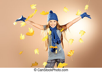 leafage - Joyful cute girl in autumn clothes throwing maple...