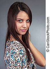 Closeup portrait of beautiful young woman with  long hair