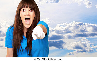 woman screaming and pointing finger, outdoor