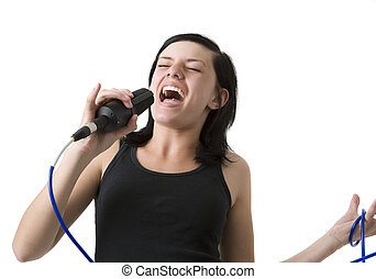 Girl sings - A girl sings loudly into a mic
