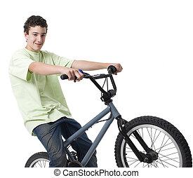 Boy rides bike - A boy rides his bike and smiles