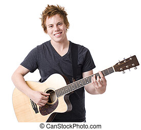 Boy with acoustic guitar - A boy smiles as he plays a guitar