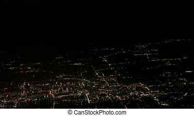 Airplane flying over big city - Aerial view of city of...