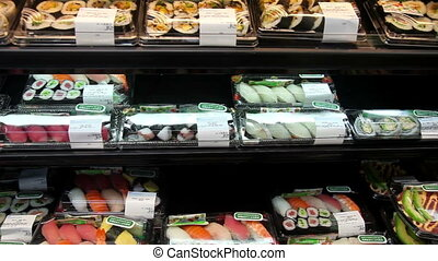 Sushi in a supermarket - Pan over a japanese section in a...
