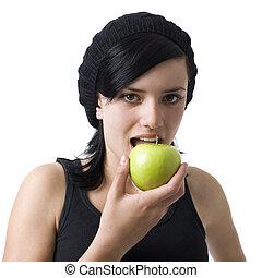 Girl eats an apple - A girl eats a green apple