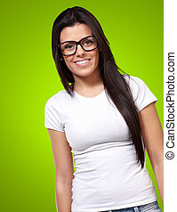 Portrait Of A Young Girl Wearing Specs Isolated On Green...