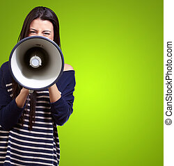 Portrait Of A Female With Megaphone On Green Background